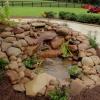 La construcción de un estanque de jardín y cascada