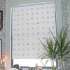 Cómo decorar y colgar una cortina de la ventana