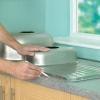 Cómo instalar un fregadero de la cocina en un laminado o madera encimera