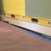 Cómo instalar revestimiento de ladrillos en una pared