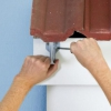 Cómo instalar vinilo o de metal canalones