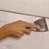 ¿Cómo reparar una pared de yeso