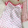 Cómo coser un vestido de bebé de punto