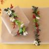 Cómo envolver un regalo en guirnalda floral