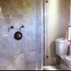 La anatomía de una ducha y cómo instalar una bandeja baja