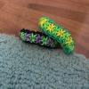 Cómo hacer una estrella de la pulsera de Rainbow Loom Cruz