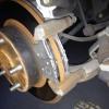 Cómo reemplazar los descansos trasero en un Acura TSX
